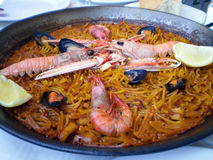 Fideua shellfish paella typical Valencias cuisine. Close up view of an authentic Fideua shellfish paella from valencia. (Is a Delicious shellfish Paella of Stock Photography