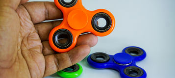 Fidget πίεση κλωστών δάχτυλων, παιχνίδι ανακούφισης ανησυχίας Στοκ Φωτογραφία