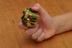 Fidget cube. Child hand holding a fidget cube - ahhd Stock Images