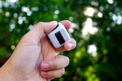 Fidget cube. Stress reliever, fingers toy in bokeh background, white. & x28;relax& x29 Stock Photos