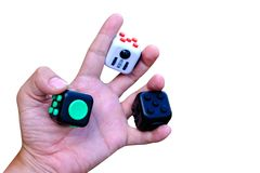 Fidget cube. Stress reliever, fingers toy on white background, isolated. clipping path Royalty Free Stock Photography