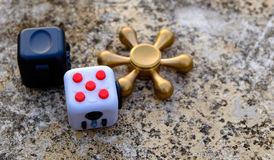 Fidget Cube. Stress reliever, fingers toy on background, spinner& x28;relax& x29 Stock Images