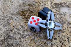 Fidget Cube. Stress reliever, fingers toy on background, spinner& x28;relax& x29 Royalty Free Stock Photos