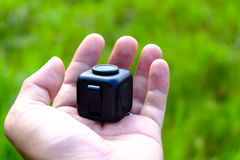 Fidget Cube. Stress reliever, fingers toy, black. & x28;relax& x29 Royalty Free Stock Photo
