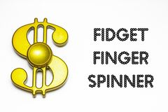 Fidget finger spinner. Closeup images of golden fidget finger spinner stock photography