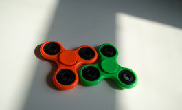 Fidget finger spinner stress, anxiety relief toy on table. Fidget finger spinner stress, anxiety relief toy royalty free stock images