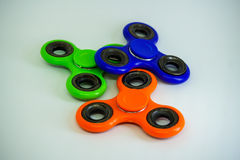 Fidget finger spinner stress, anxiety relief toy. A fidget spinner is a type of stress-relieving toy. A basic fidget spinner consists of a bearing in the center stock images