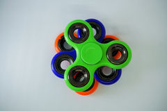 Fidget finger spinner stress, anxiety relief toy. A fidget spinner is a type of stress-relieving toy. A basic fidget spinner consists of a bearing in the center royalty free stock photography