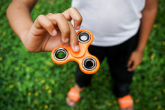 Fidget finger spinner stress, anxiety relief toy Stock Photography