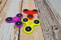 Fidget finger spinner on wooden background Royalty Free Stock Photography
