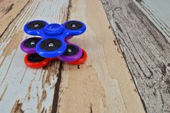 Fidget finger spinner on wooden background Stock Images
