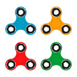 Fidget hand spinner toy for increased focus, stress relief. Relaxation device. Royalty Free Stock Photography