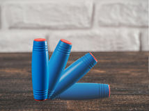 Fidget rolling stick toy flip blue color isolated royalty free stock photo