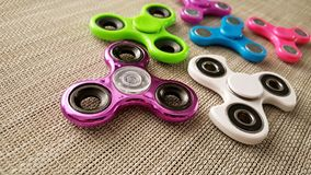 Fidget Spinner. Antistress, therapy. autism therapy. Fidget Spinner in hand. antistress toys for autism people. new sales hit Royalty Free Stock Photos