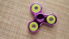 Fidget Spinner. Antistress, therapy. autism therapy. Fidget Spinner in hand. antistress toys for autism people. new sales hit Stock Photography