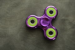 Fidget Spinner. Antistress, therapy. autism therapy. Fidget Spinner in hand. antistress toys for autism people. new sales hit Royalty Free Stock Photo