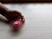Fidget spinner on a boys hand stock photography