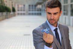 Fidget spinner entertaining elegant businessman Stock Photography