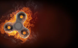 Fidget spinner in fire  on black background banner. Stock Photos