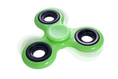 Fidget spinner green turning Stock Photos