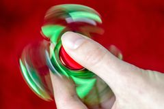 Fidget spinner in hand Royalty Free Stock Photo