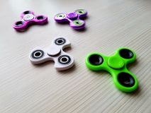 Fidget Spinner. Antistress, therapy. autism therapy. Fidget Spinner in hand. antistress toys for autism people. new sales hit Royalty Free Stock Photography