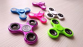 Fidget Spinner. Antistress, therapy. autism therapy. Fidget Spinner in hand. antistress toys for autism people. new sales hit Royalty Free Stock Image