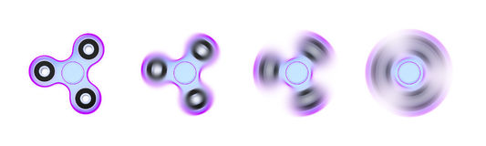A fidget spinner in motion Stock Photo
