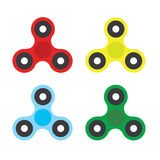 Fidget Spinner - 3 pronged hand toy spun by its center Royalty Free Stock Image
