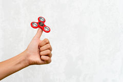 Fidget spinner. Red hand spinner, fidgeting hand toy rotating on child`s hand. Stress relief. Anti stress and relaxation adhd att. Ention fad boy concept. Free royalty free stock images