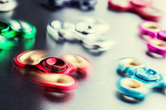 Fidget Spinner. Several colorful fidget spinners on a stainless steel plate Stock Photography