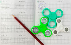 Fidget spinner stress relieving toy on notebook background stock photography