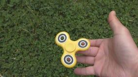 Fidget spinner turns on the finger.