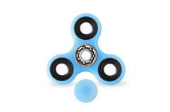 Fidget spinner on white background with opened cap. Blue fidget spinner popular toy on white background with opened cap, mechanism visible Stock Images