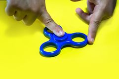fidgeting hand toy rotating on child's finger stock photos