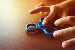 fidgeting hand toy rotating on child's finger royalty free stock photos