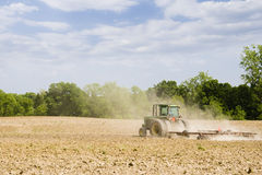 In the field. Spring field preparation work: tilling soil Stock Photography