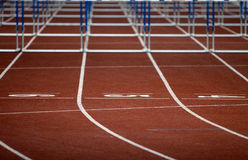 Field. An athletic field with the hurdles in the background Stock Photo