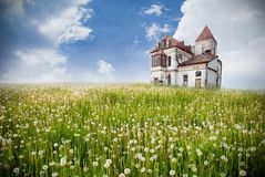 Field and abandoned house Stock Photos