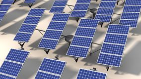 Field of articulated solar panels in morning Royalty Free Stock Image