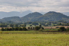 Field in the background mountains. Summer Mountains Rudawy Janowickie second background Karkonosze - Giant Mountains. Poland royalty free stock photography