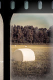 Field with bales on old film strip Royalty Free Stock Image