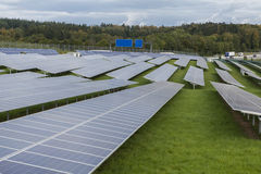 Field with blue siliciom solar cells alternative energy. To collect sun energy royalty free stock image