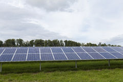 Field with blue siliciom solar cells alternative energy. To collect sun energy stock photos