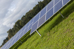 Field with blue siliciom solar cells alternative energy. To collect sun energy royalty free stock images