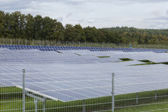 Field with blue siliciom solar cells alternative energy. To collect sun energy Royalty Free Stock Photography