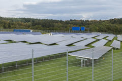 Field with blue siliciom solar cells alternative energy. To collect sun energy Royalty Free Stock Photo