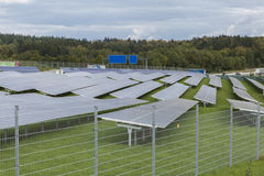 Field with blue silicion solar cells alternative energy. To collect sun energy royalty free stock images
