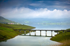 Field bridge and lake with dike Royalty Free Stock Photos
