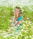 Field of camomiles and young woman Royalty Free Stock Photo